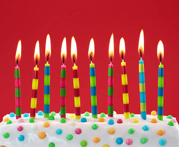 Ten colorful candles stock photo