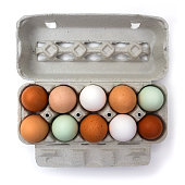 Ten colorful chicken eggs in carton box, isolated on white