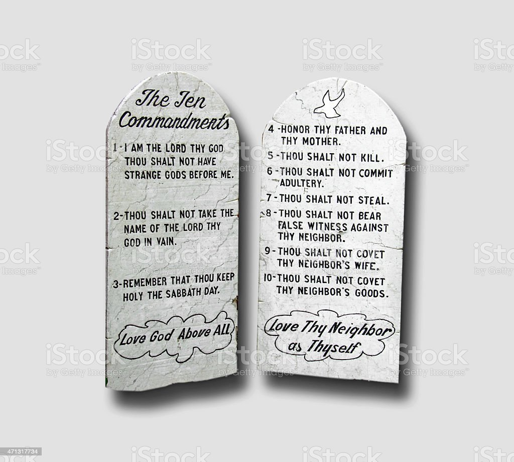 Ten Commandments carved into pieces of marble, isolated, with shadow stock photo