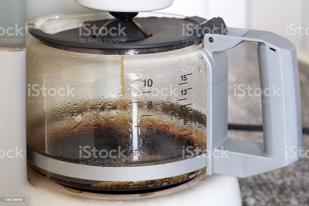 Ten cup coffee pot with white handle and fresh coffee stock photo