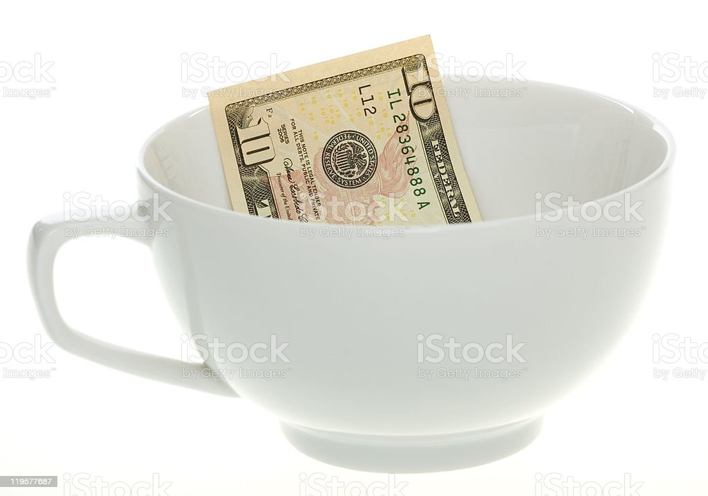 Ten Dollar Bill in a White Coffee Mug stock photo