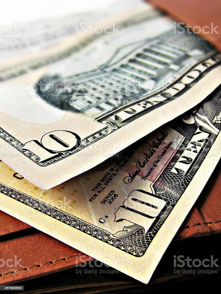 Ten dollar bills cash on a wallet close up macro stock photo