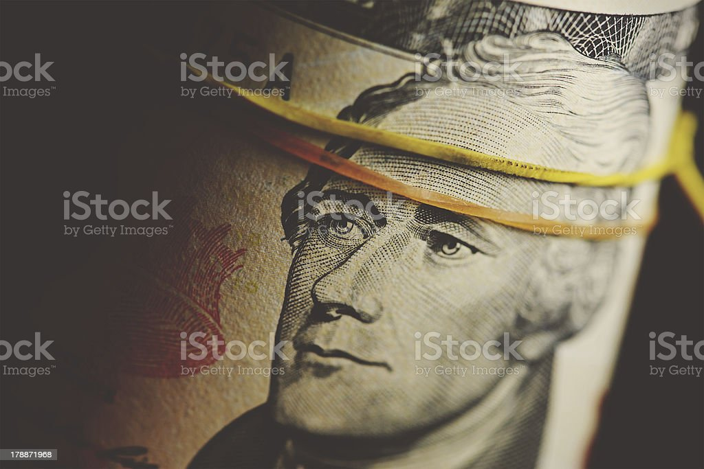Ten dollars bill in roll. royalty-free stock photo