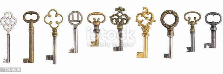 Ten old keys on white background