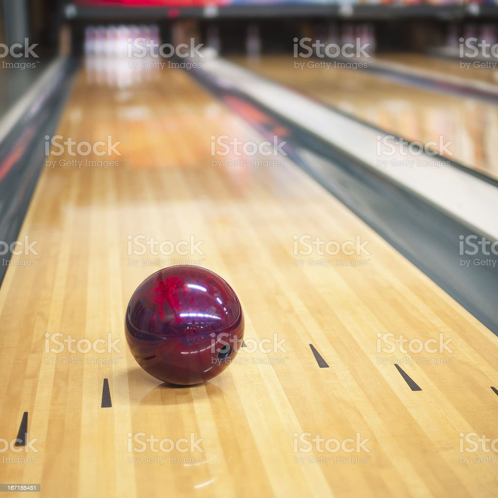 bowling shoot with bowlingball and pins.