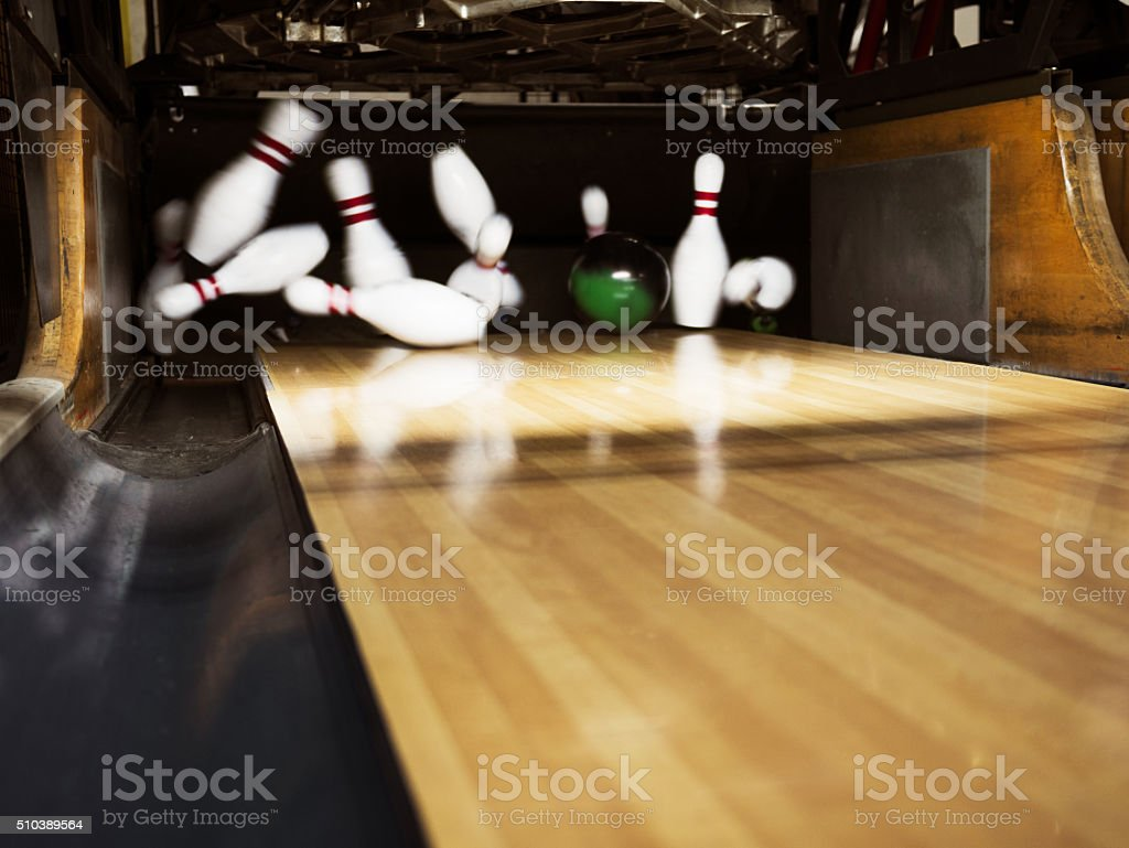 Ten pin bowling strike stock photo