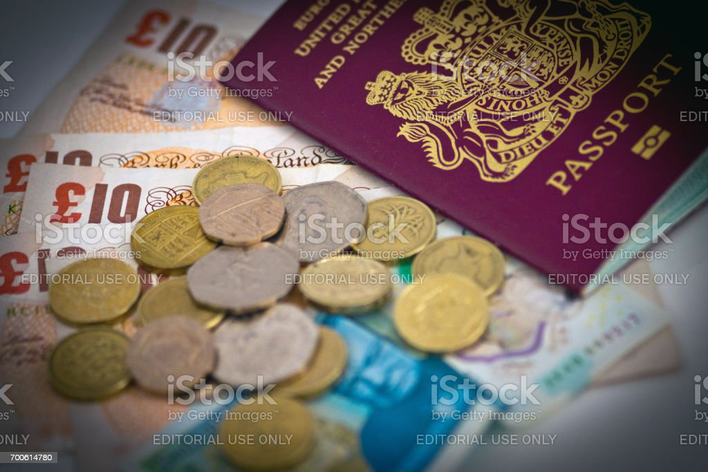 Ten pound and five pound notes and change with passport. stock photo