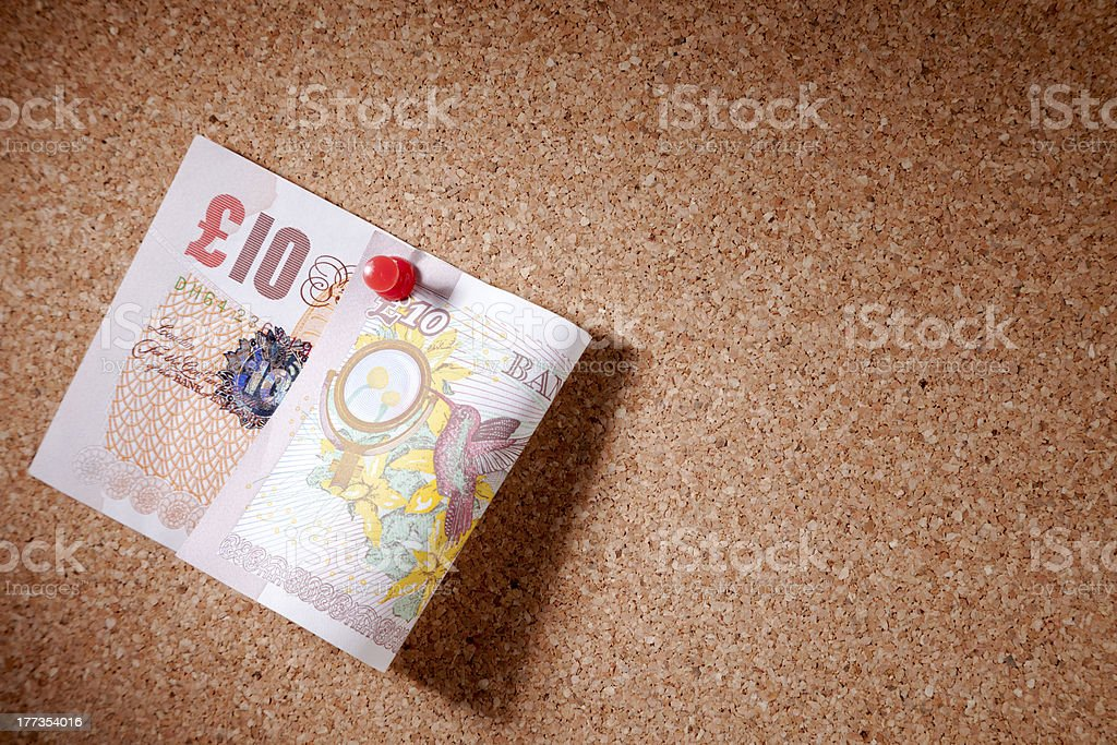 Ten Pound Note Pinned To A Corkboard stock photo
