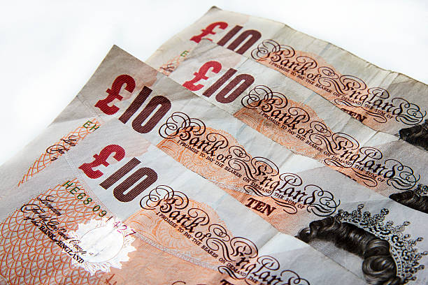 Ten Pound notes British banknotes pictured on a white background ten pound note stock pictures, royalty-free photos & images