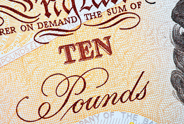 Ten Pounds Abstract shot of a British Ten Pound (£10) Note. ten pound note stock pictures, royalty-free photos & images
