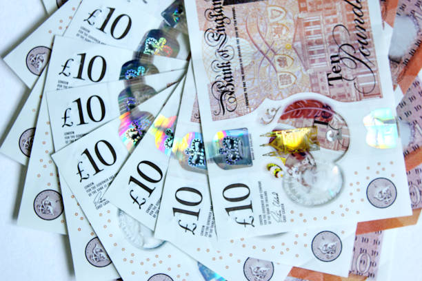 Ten Pounds Sterling Ten pound notes arranged in a spiral pattern. ten pound note stock pictures, royalty-free photos & images