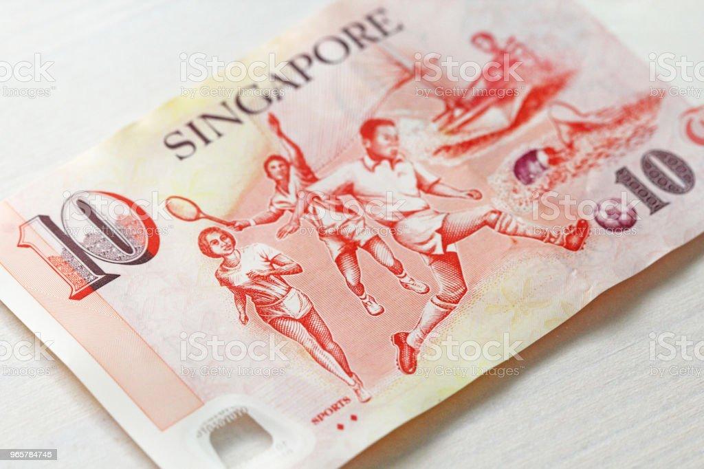 Tien Singaporese Dollars met één nota. 10 dollar - Royalty-free Amerikaanse dollar Stockfoto