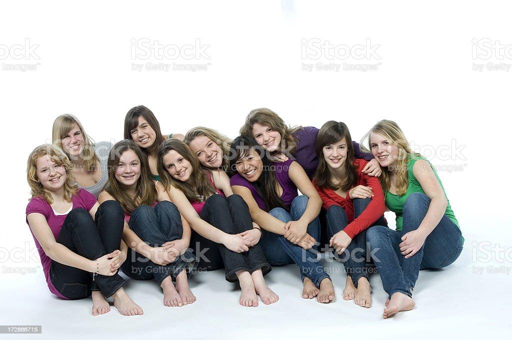 Десять улыбающегося девушки на полу стоковое фото