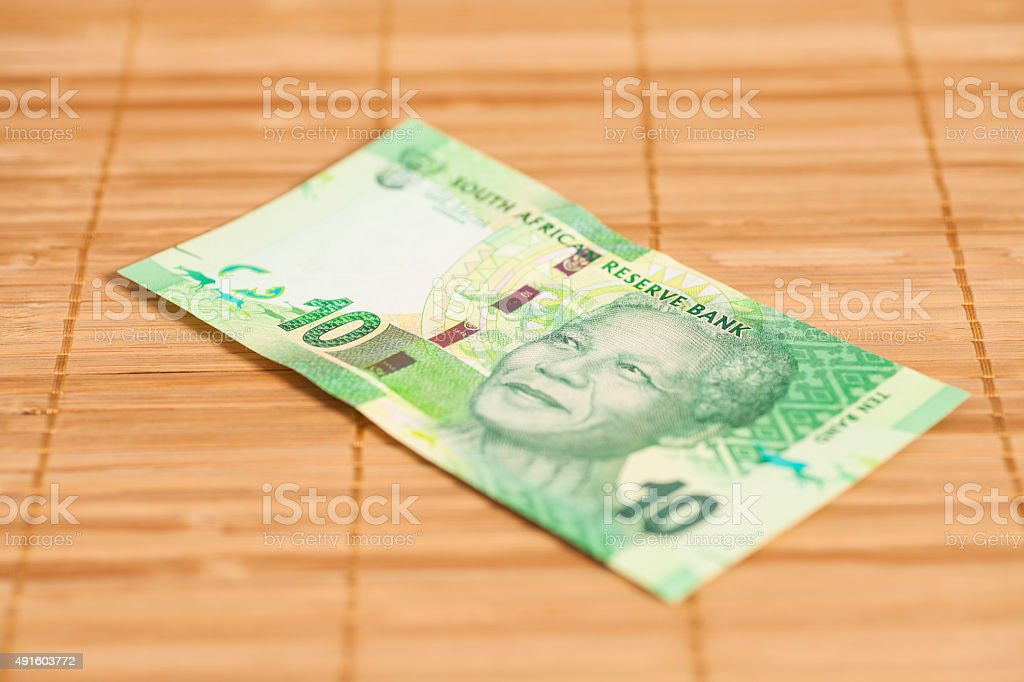 Ten South African Rand on wooden background stock photo