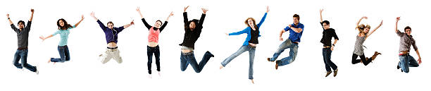 Ten students leaping stock photo