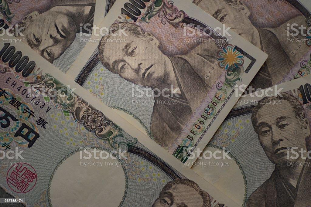 Ten thousands japanese yen bills stock photo