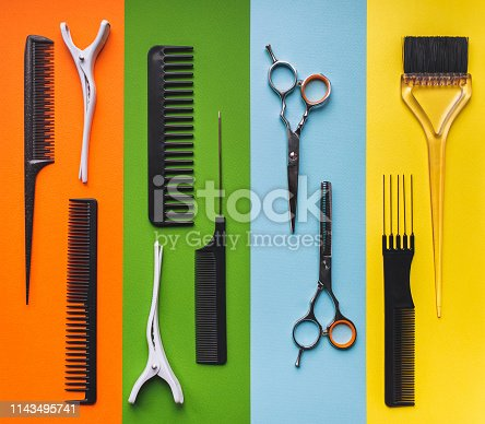 696318954 istock photo Ten tools hairdresser on the background of pastel paper in the form of multi-colored stripes. Barbershop. 1143495741