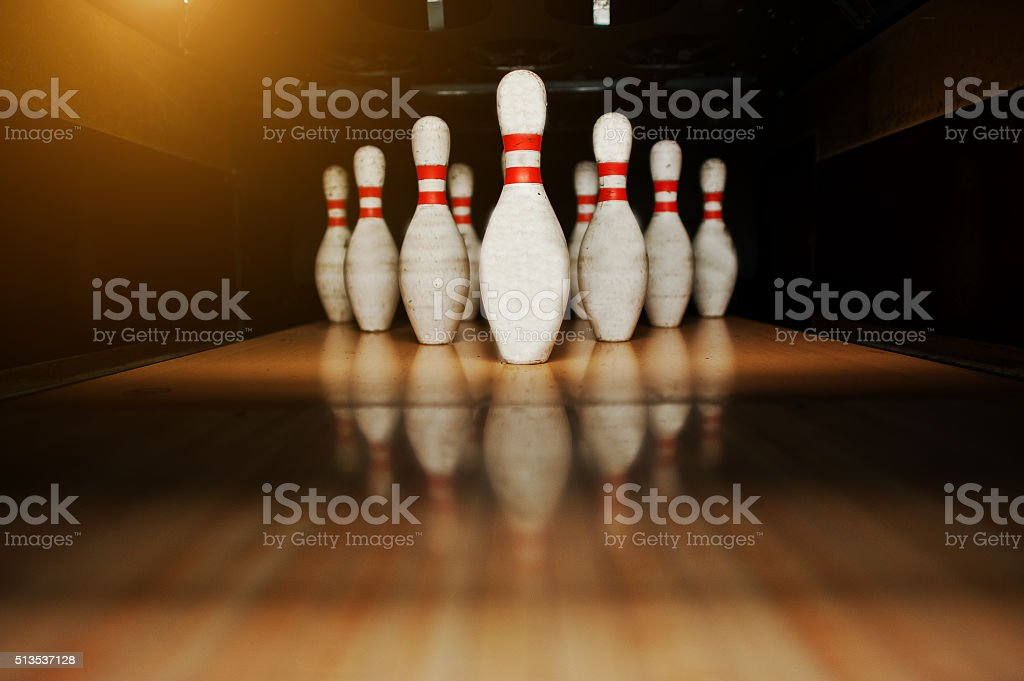 Ten white pins in a bowling alley lane stock photo