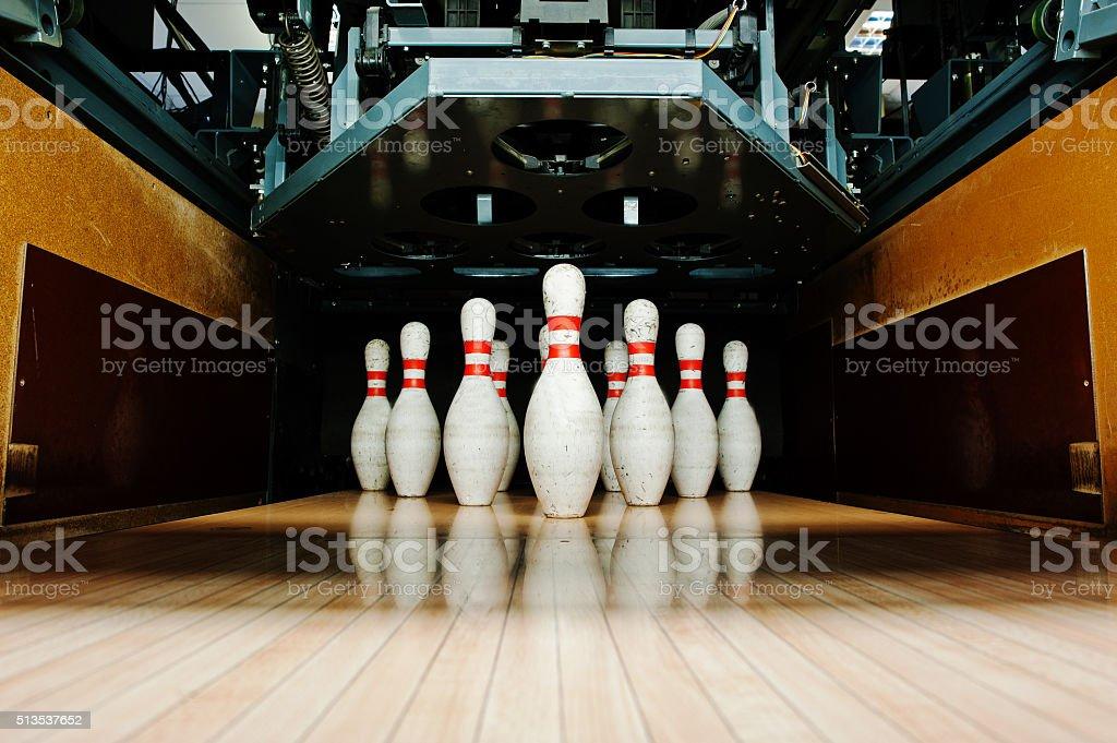 Ten white pins in a bowling alley lane stock photo