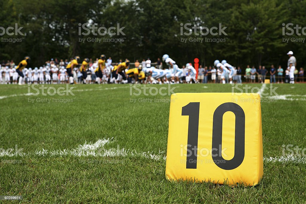 ten yard marker with play behind stock photo