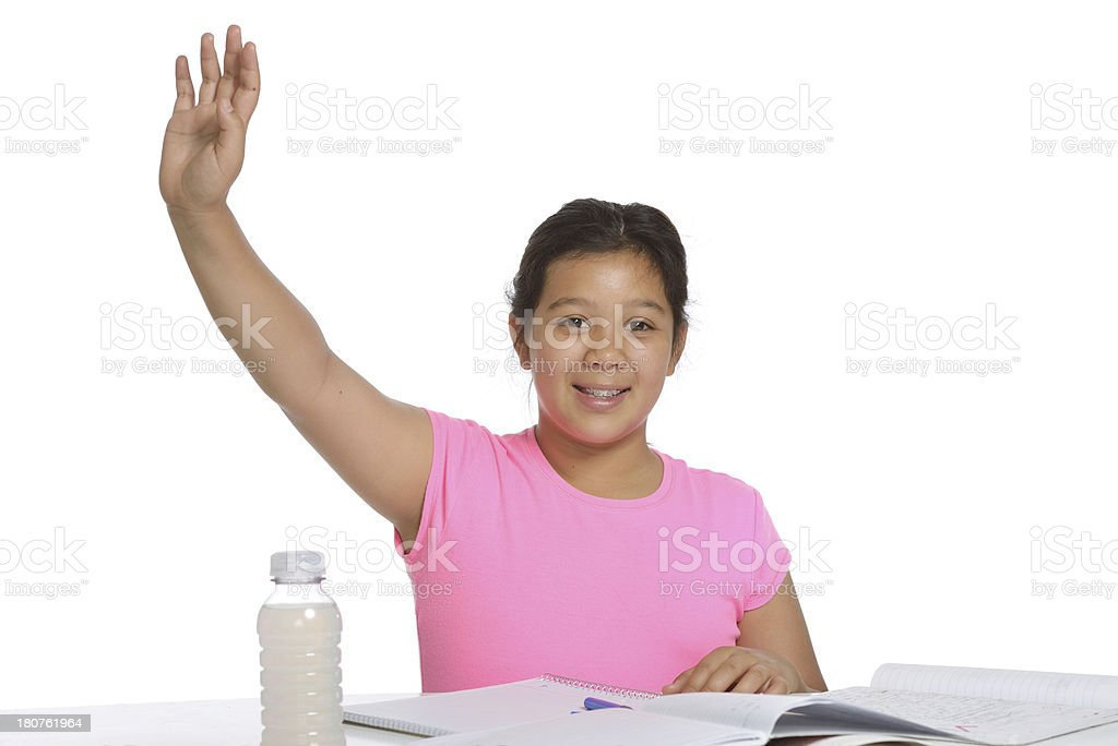 Ten year old elementary student rasing her hand royalty-free stock photo