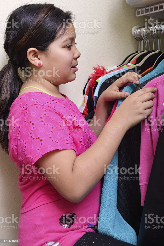 Ten year old girl choosing her clothes royalty-free stock photo