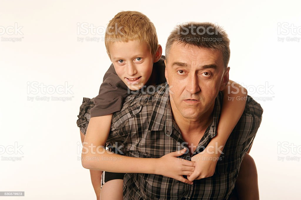 Ten year old son cheerfully embraced his father stock photo