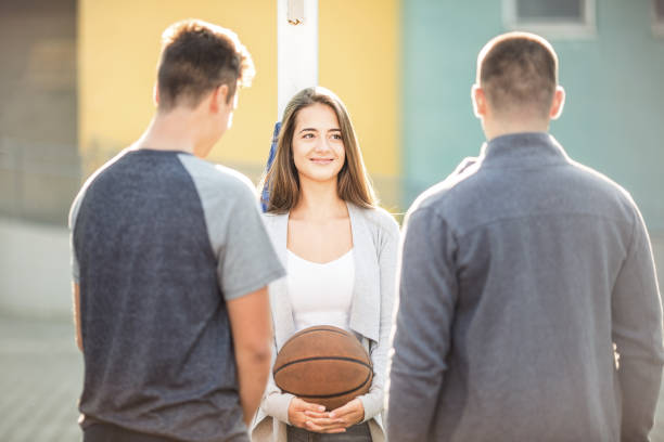 Tenage girl with basketball ball stock photo