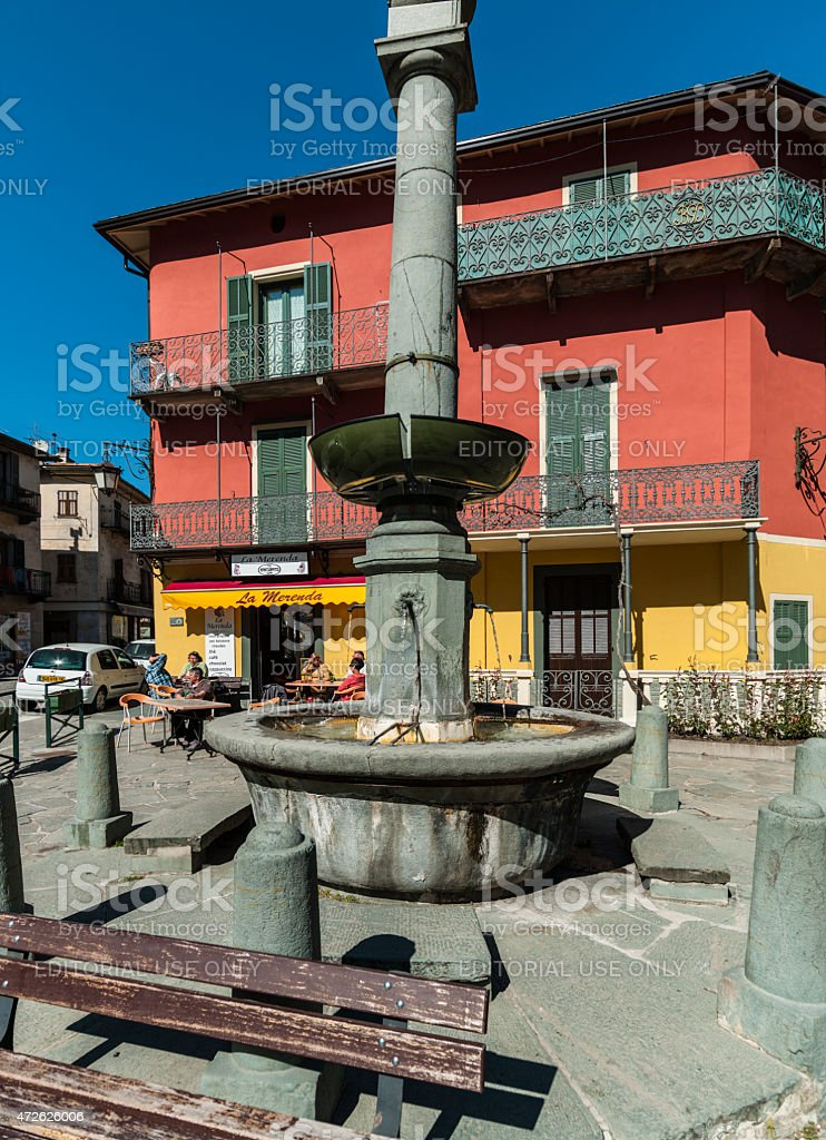 Tende (France). Little square with fountain and tourists stock photo