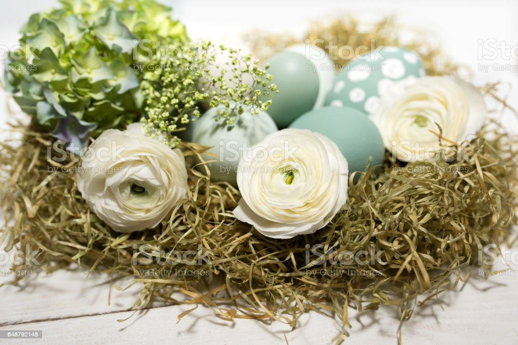 Tender easter decoration with eggs in a nest stock photo