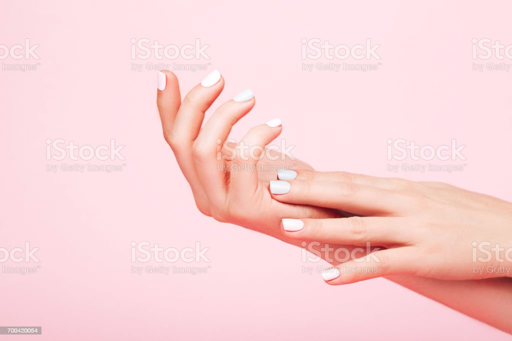Tender hands with perfect manicure stock photo
