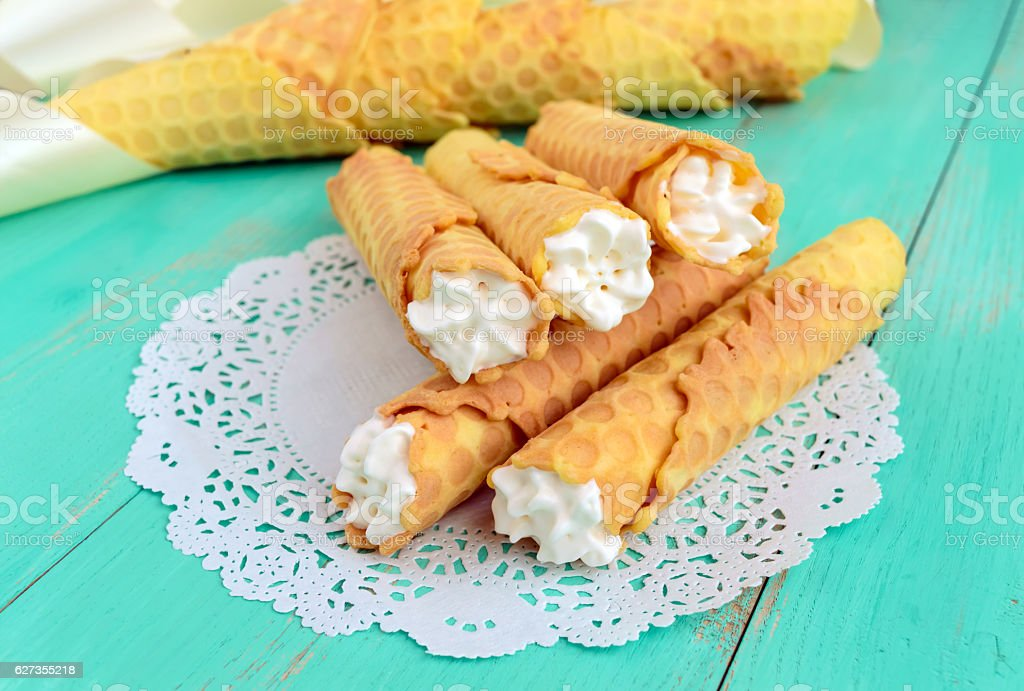 Tender honey wafers in the form of tubes stock photo