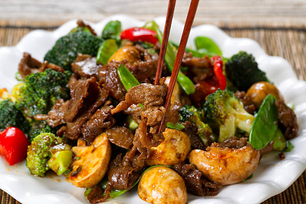 tender juicy beef slices and mixed vegetables ready to eat - chinese food stock photos and pictures