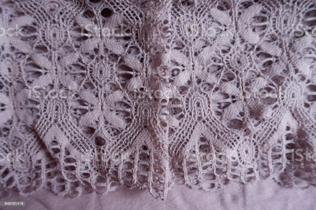 Tender lace on simple puce viscose fabric stock photo