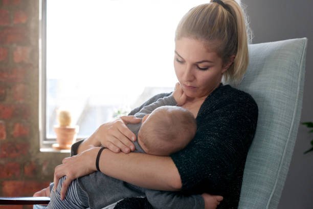 Tender moment woman breast feeding baby