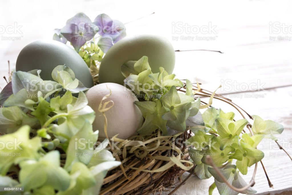 Tender still life with easter eggs in a nest stock photo