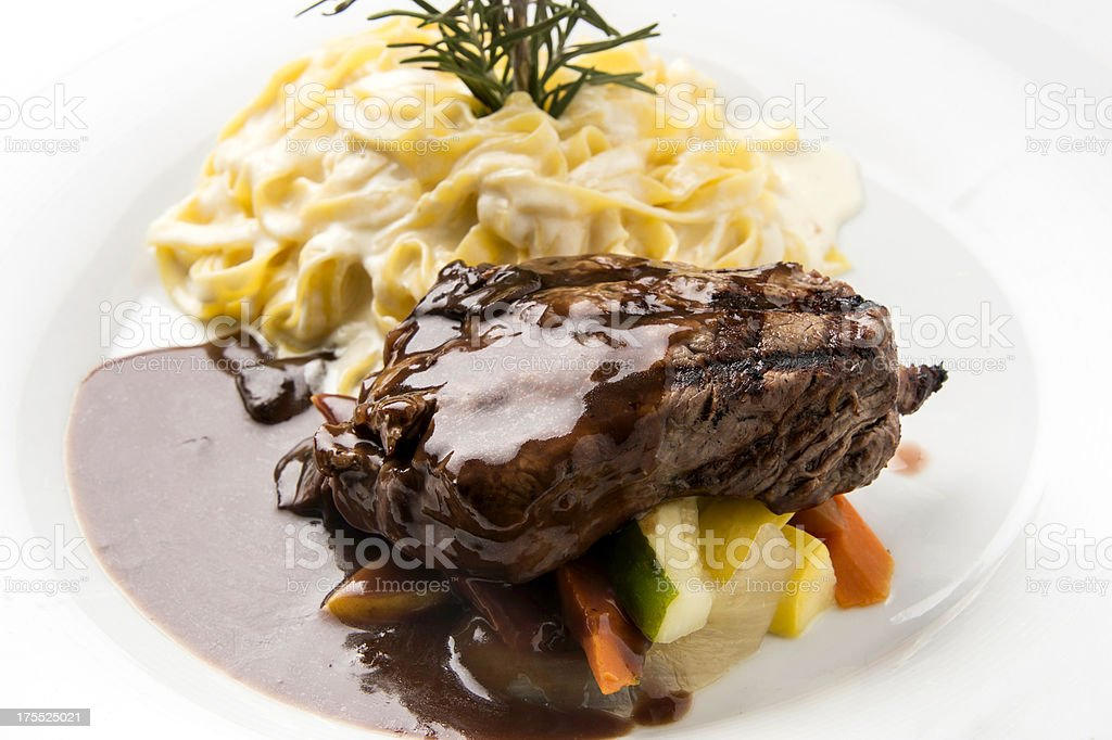 Tenderloin filet with a sauces & red wine reduction w/ pasta royalty-free stock photo
