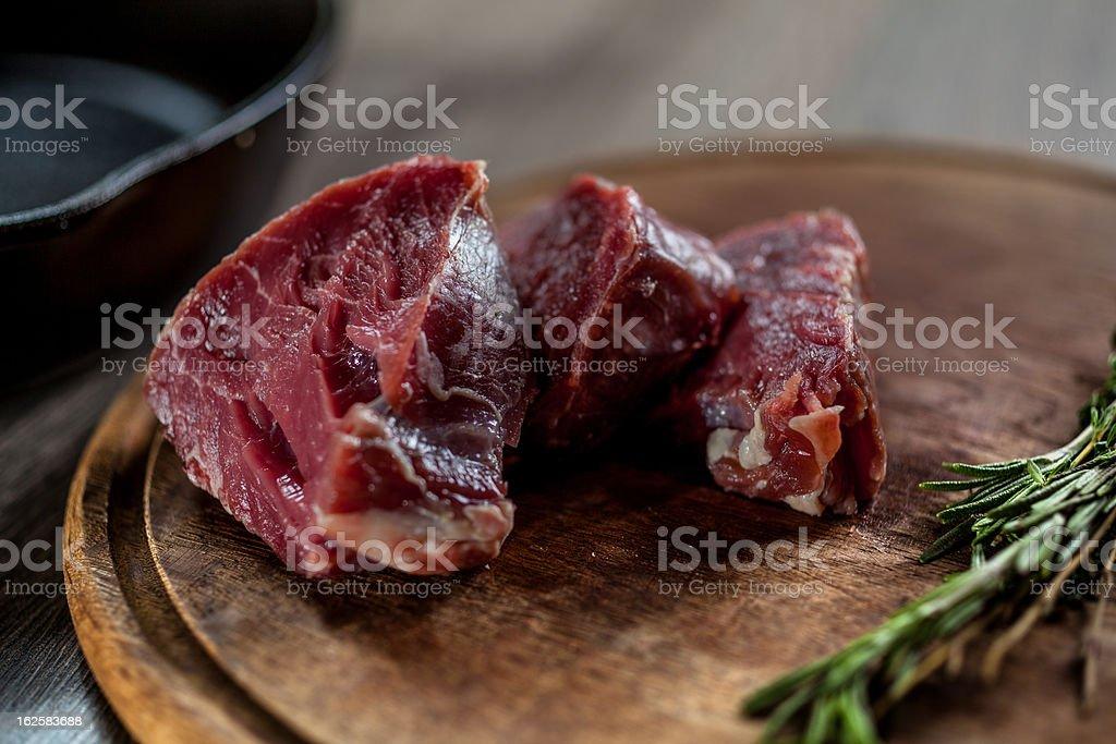 Tenderloin fillet cut into steaks royalty-free stock photo