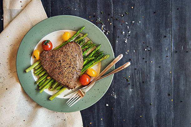 Tenderloin steak with grilled asparagus and cherry tomatoes stock photo