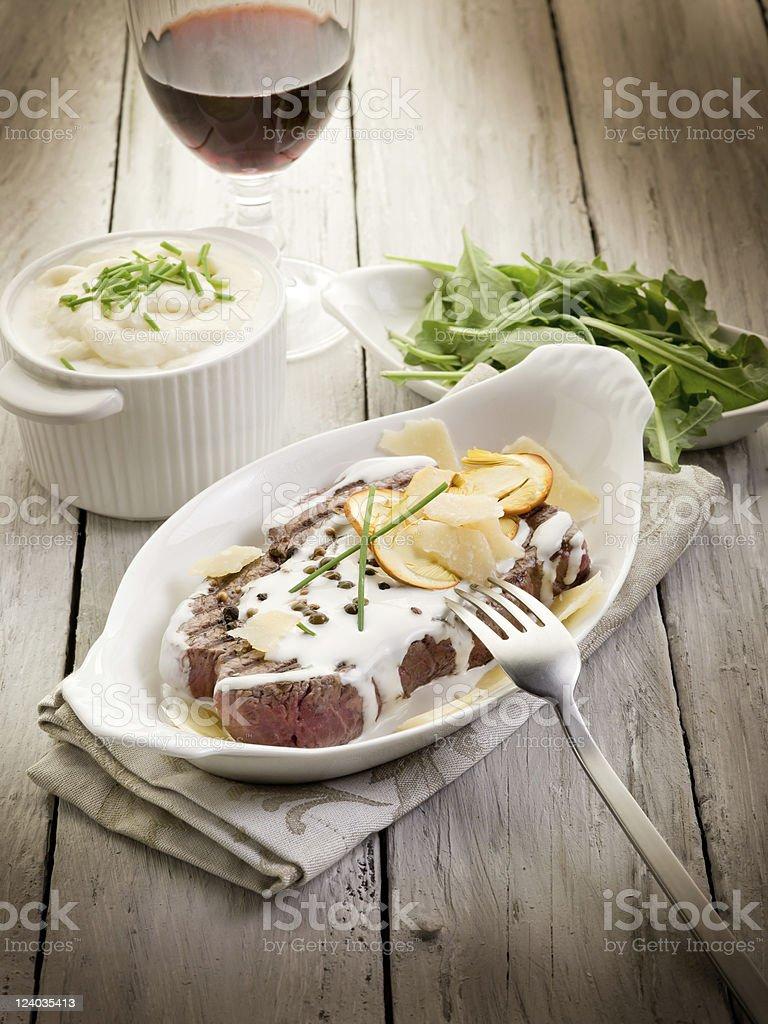 tenderloin with cream sauce ovum mushroom and arugula salad royalty-free stock photo