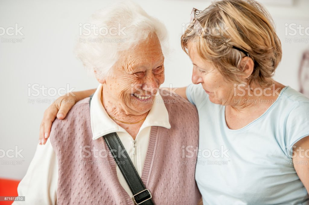 Tenderness Between Senior Mother And Mature Daughter stock photo