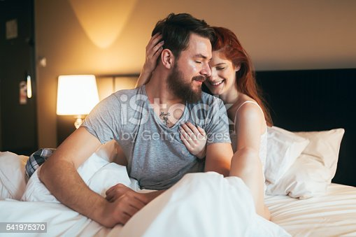 istock Tenderness od a beautiful couple in bedroom 541975370