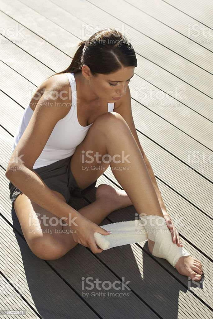 Tending to the pain stock photo