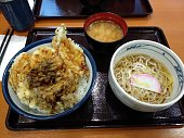 Tendon menu composed of tempura vegetables with rice, udon noodles and miso soup