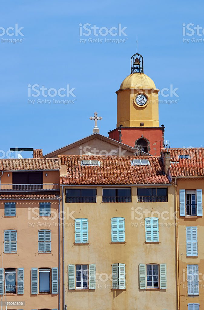 Tenement houses and church in the port of Saint-Tropez stock photo