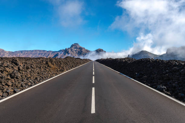 Tenerife Car Road in El Teide National Park Tenerife Car Road in El Teide National Park straight stock pictures, royalty-free photos & images
