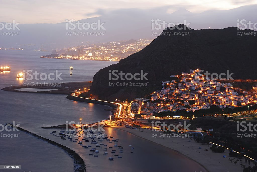 tenerife coast at night, Santa Cruz in background, Canary Islands stock photo