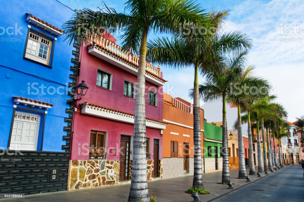 Tenerife. Colourful houses and palm trees on street in Puerto de la Cruz town, Tenerife, Canary Islands, Spain stock photo