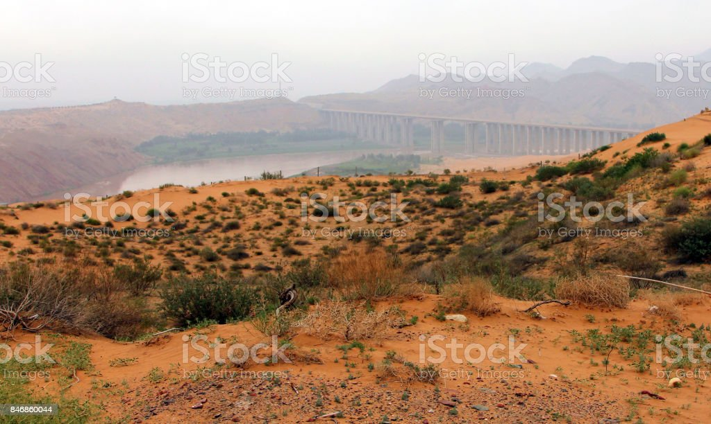 Tengger desert on a background of Yellow river (Huang He), Shapotou district, China stock photo