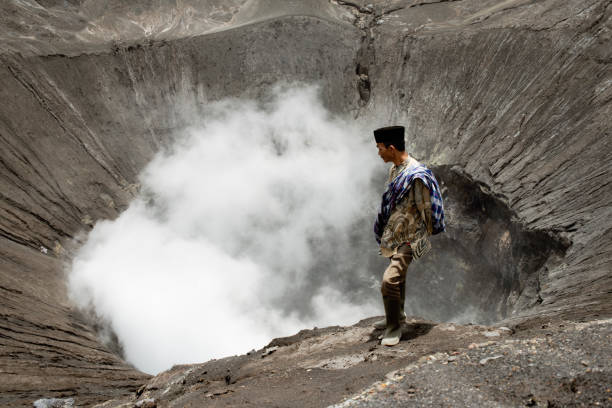 Tenggerese Man Standing On The Edge Of An Active Volcano In Bromo Tengger Semeru National Park – Foto